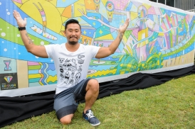 Artist Go Suga with his winning design for the project construction site fencing